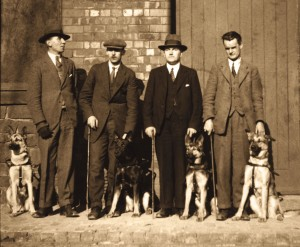 The four original guide dogs and their owners