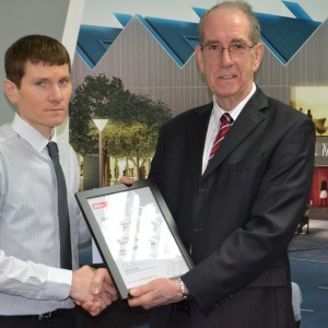 Stephen Bentley receiving award from Ron Faulkner